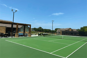 Residential Tennis Court and Batting Cage Laykold tennis court surfacing